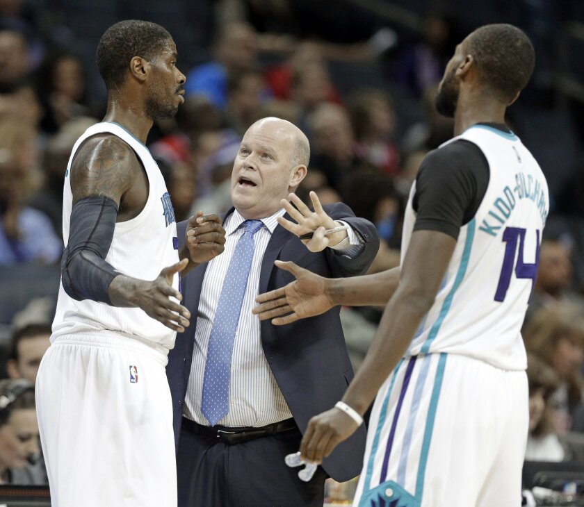 Charlotte Hornets head coach Steve Clifford, center, talks with Marvin Williams, left, and Michael Kidd-Gilchrist, right, in the first half of an NBA basketball game against the Chicago Bulls in Charlotte, N.C., Monday, Feb. 8, 2016. (AP Photo/Chuck Burton)