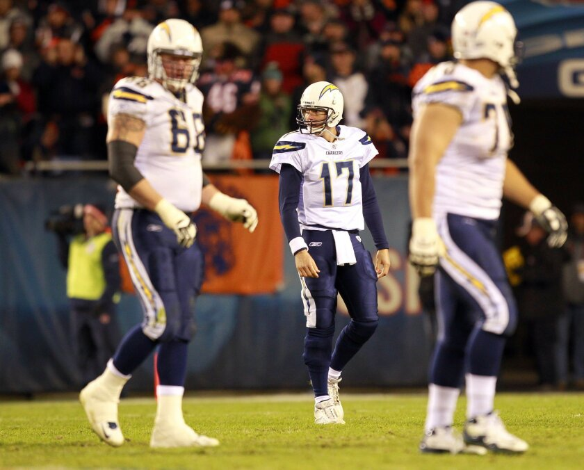 Chargers Philip Rivers walks off after throwing an interception in the final minutes against the Bears at Soldier Field  on Sunday, Nov. 20, 2011.