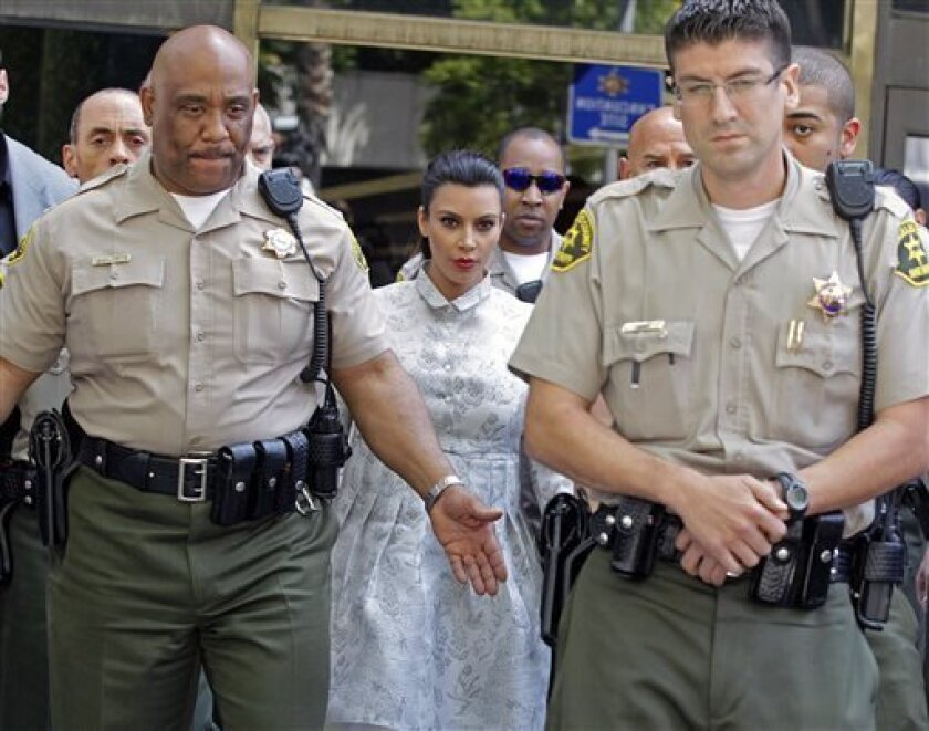TV personality Kim Kardashian leaves Los Angeles County Superior Court after a hearing in her divorce from Kris Humphries, Friday, April 12, 2013. Humphries, a power forward for the Brooklyn Nets, did not attend the hearing. The reality star wants a divorce to end her 72-day marriage to Humphries, but the NBA player wants it annulled. He claims the marriage was based on fraud, but he would have to approve the allegation at trial. Humphries' attorneys declined to comment on settlement discussion