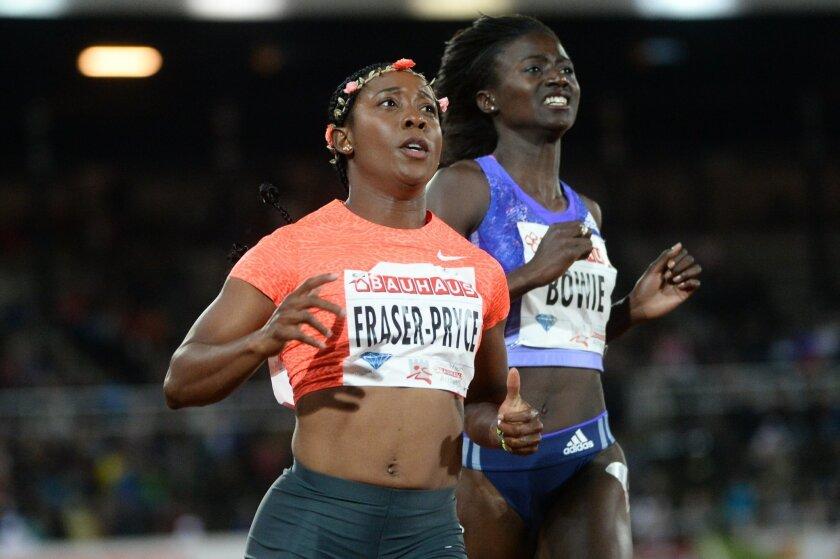 Shelly-Ann Fraser-Pryce of Jamaica, left, wins the women's 100m race ahead of Tori Bowie of the U.S at the IAAF Athletics Diamond League meeting at Stockholm Olympic Stadium on Thursday July 30, 2015. (Fredrik Sandberg/TT via AP)