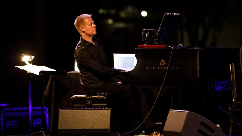 """Max Richter performs """"Sleep"""" as people lay in cots in Grand Park to sleep overnight as music plays o"""