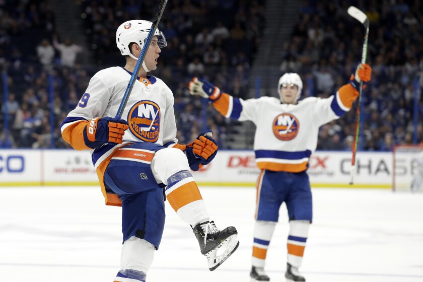 New York Islanders center Brock Nelson (29) celebrates his goal against the Tampa Bay Lightning during the third period of an NHL hockey game Monday, Dec. 9, 2019, in Tampa, Fla. (AP Photo/Chris O'Meara)