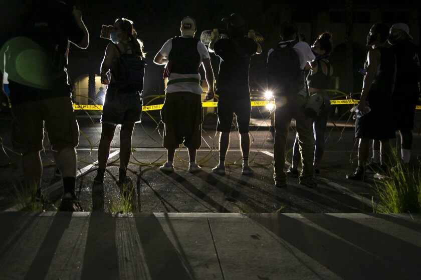 Protesters during a protest for Dijon Kizzee outside the sheriff's office in the South borough of Los Angeles.