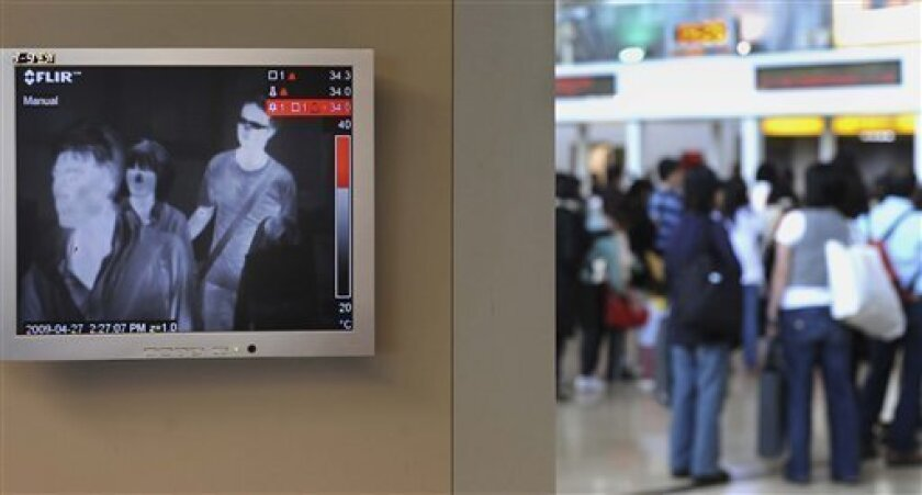 FILE - In this April 27, 2009 file photo, in hopes of spotting feverish travelers, thermal images are seen on a monitor showing recent arrivals to the Taoyuan International Airport, in Taoyuan, Taiwan. Because of swine flu fears, airports around the world are installing thermal imaging cameras to take travelers' temperatures without having to stick thermometers in their mouths. (AP Photo, File)