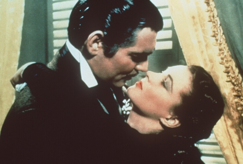 """Rhett Butler (Clark Gable) and Scarlett O'Hara (Vivien Leigh) in the movie """"Gone With the Wind"""" from 1939."""