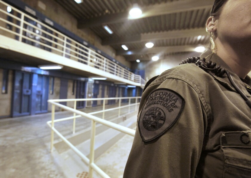A correctional officer works at one of the housing units at Pelican Bay State Prison near Crescent City, Calif.