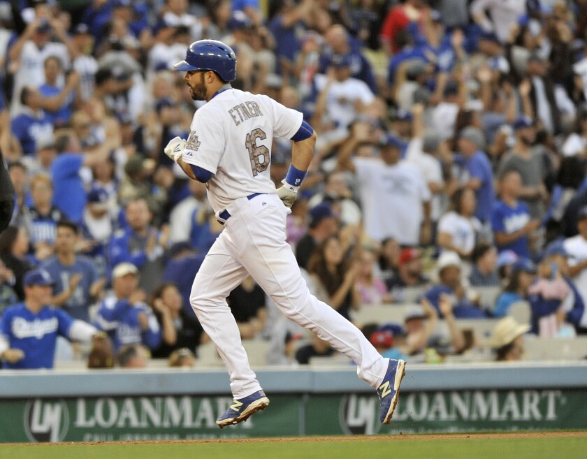 Dodgers outfiedler Andre Ethier rounds the bases after hitting the go-ahead home run against the Braves during the eighth inning.