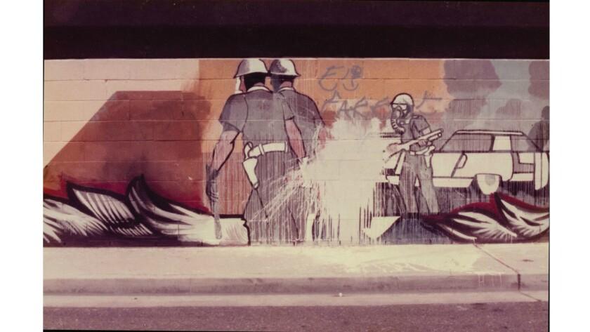 "A vandalized panel of Sergio O'Cadiz Moctezuma's ""Fountain Valley Mural."""