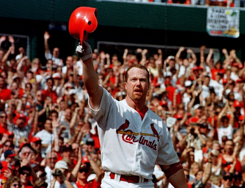 FILE - In this Sept. 27, 1998, file photo, St. Louis Cardinals slugger Mark McGwire tips his helmet to the crowd after hitting his 69th home run of the season, off Montreal Expos pitcher Mike Thurman, in a baseball game at Busch Stadium in St. Louis. The chances of Roger Clemens, Barry Bonds, Sammy