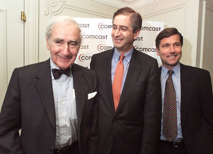 Comcast Chairman Ralph Roberts, left, President Brian Roberts, center, and Steve Burke, president of Comcast Cable, in 2001 after Comcast offered to buy AT&T Broadband.
