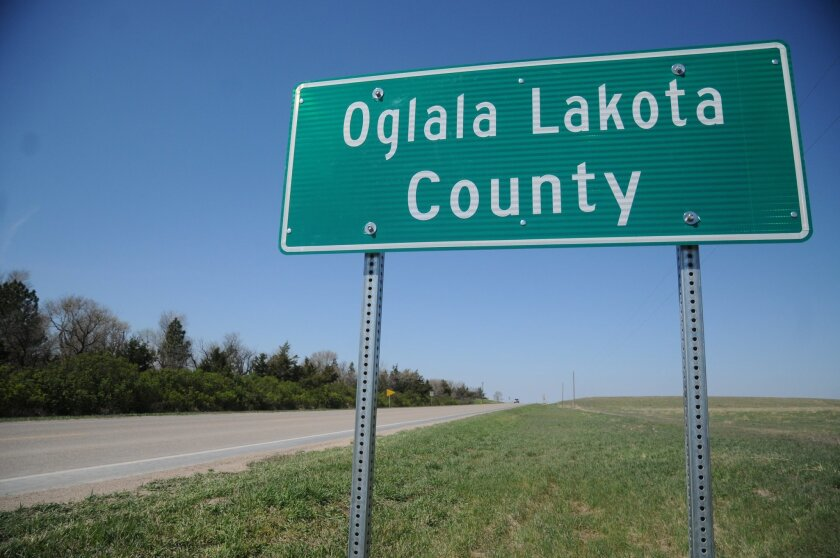 This April 29, 2015 photo shows a sign for the newly named Oglala Lakota County in Batesland, S.D. The name change will officially take effect on Friday. Shannon County has officially become Oglala Lakota County, scrubbing away the name of a man who Oglala Sioux Tribe activists say helped usher in