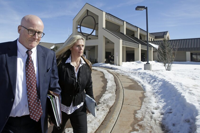 Olympic gold-medal skier Picabo Street leaves the Summit County Justice Center with her attorney Joe Wrona Tuesday, Feb. 16, 2016, in Park City, Utah. Street appeared in court Tuesday on misdemeanor domestic violence and assault charges. Street is accused of throwing her 76-year-old father down sta