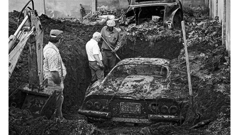 Feb. 7, 1978: A buried Ferrari stolen in 1974, is dug up from a backyard on W. 119th Street, still i