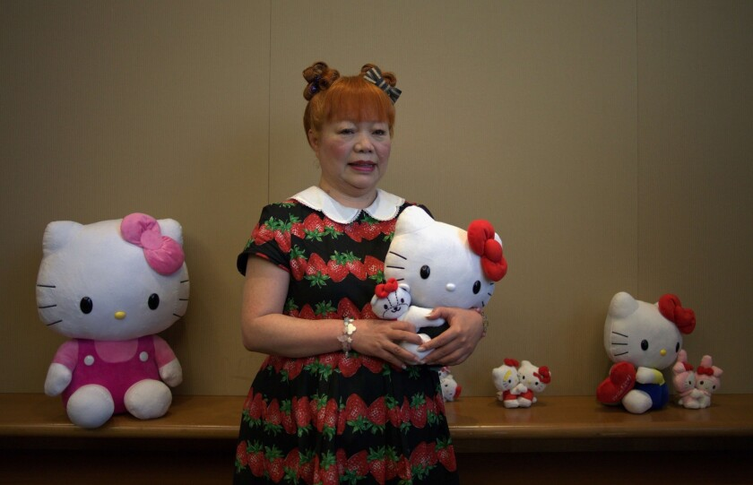 Yuko Yamaguchi, designer of Japanese cartoon and global mega-brand Hello Kitty, poses with various dolls in Hong Kong in July. She will appear on a panel at the Hello Kitty Con 2014 in Los Angeles.