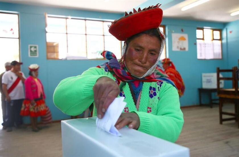 A woman arrives to vote at a polling station in Cusco, Peru, 09 December 2018. Citizens have been called to vote on a political and judiciary referendum, as well as in regional election run-offs. EFE-EPA/Leon Castellar