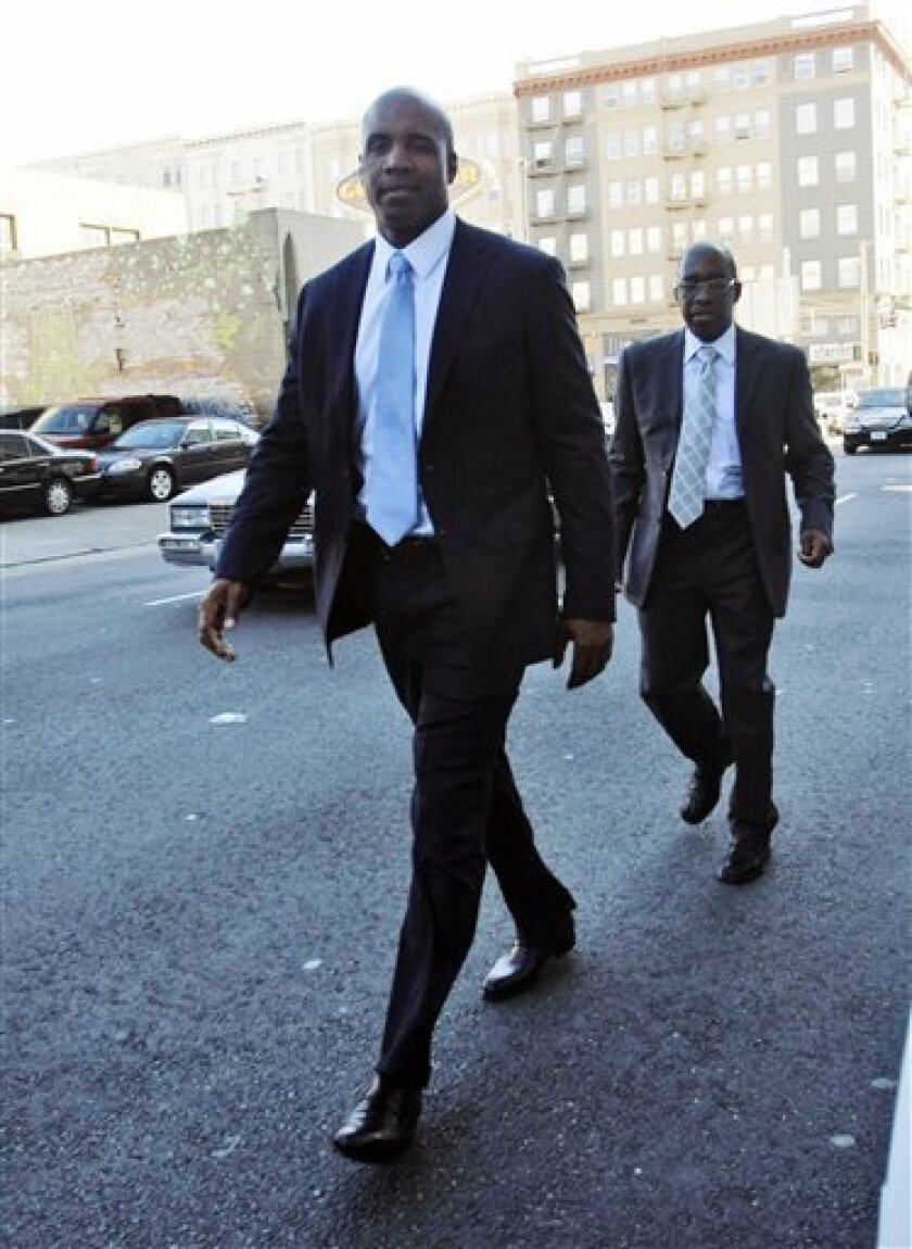 Barry Bonds leaves the federal courthouse during a break in the proceedings for his perjury trial in San Francisco, Monday, April 4, 2011. (AP Photo/Marcio Jose Sanchez)