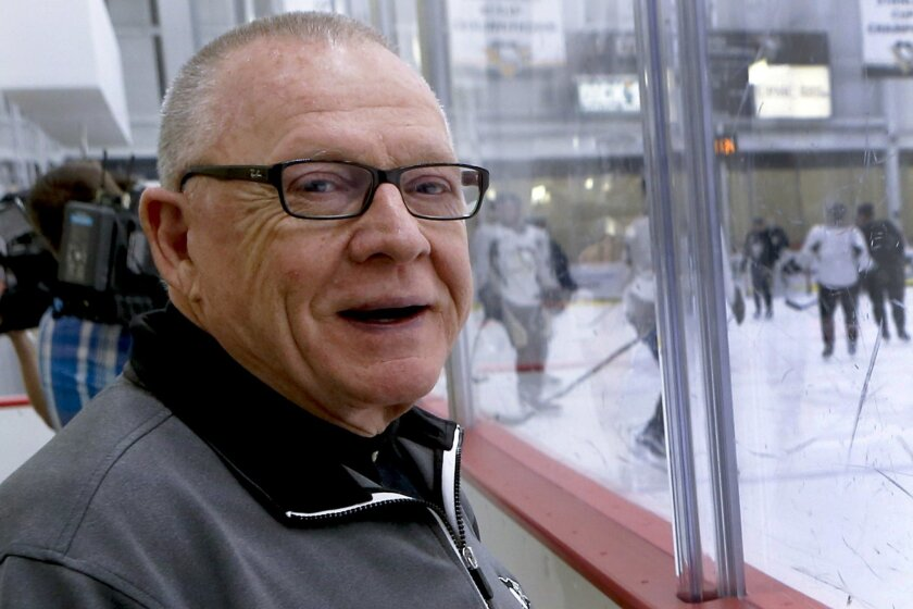 Pittsburgh Penguins general manager Jim Rutherford stands behind the glass as the team works out during NHL hockey practice at the UPMC Lemieux Sports Complex, Saturday, May 28, 2016, in Cranberry, Pa. The Penguins host the San Jose Sharks in Game 1 of the Stanley Cup Finals on Monday, May 30. Mike