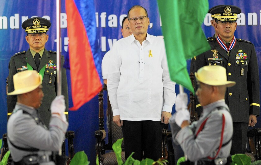 """After a bungled raid in January, the government of Philippine President Benigno Aquino III, center, has delayed plans to give the U.S. wider access to military bases that the Obama administration sought for its strategic """"pivot"""" to Asia."""