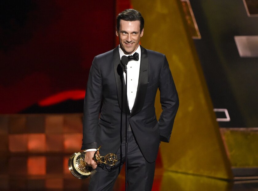 "Jon Hamm accepts the award for outstanding lead actor in a drama series for ""Mad Men"" at the 67th Primetime Emmy Awards on Sunday, Sept. 20, 2015, at the Microsoft Theater in Los Angeles. (Photo by Chris Pizzello/Invision/AP)"