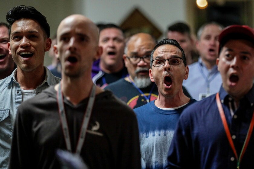 """Santo Ragno, second from right, and the """"tenor one"""" section rehearses with the rest of the Gay Men's Chorus of Los Angeles at the First Congregational Church."""