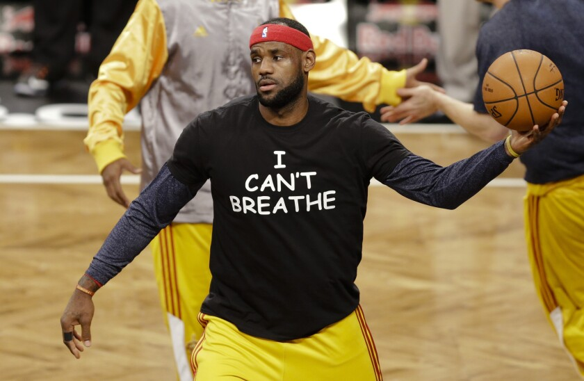 "LeBron James wears a T-shirt with the words ""I Can't Breathe"" during pregame warmups."