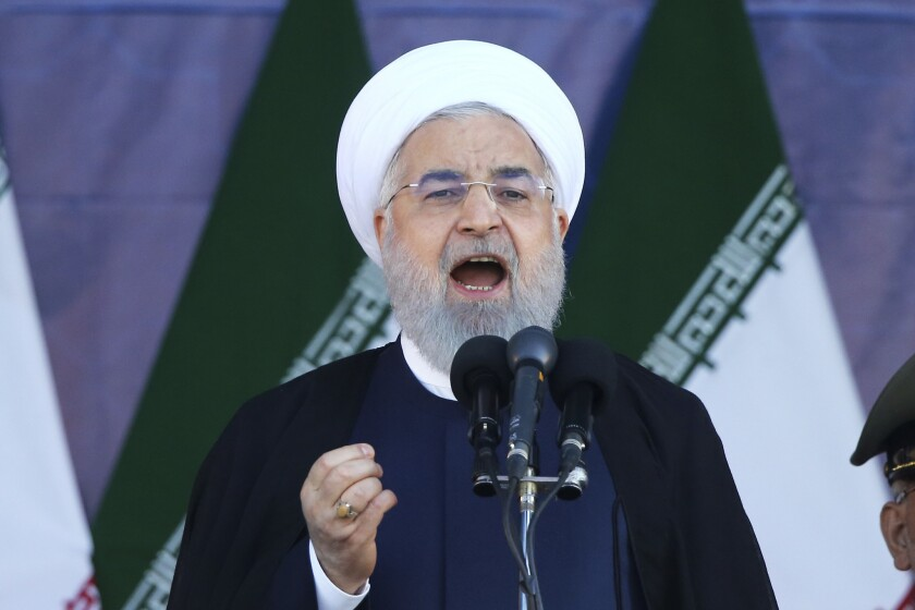 Iran's President Hassan Rouhani speaks at a military parade marking the 38th anniversary of Iraq's 1980 invasion of Iran.