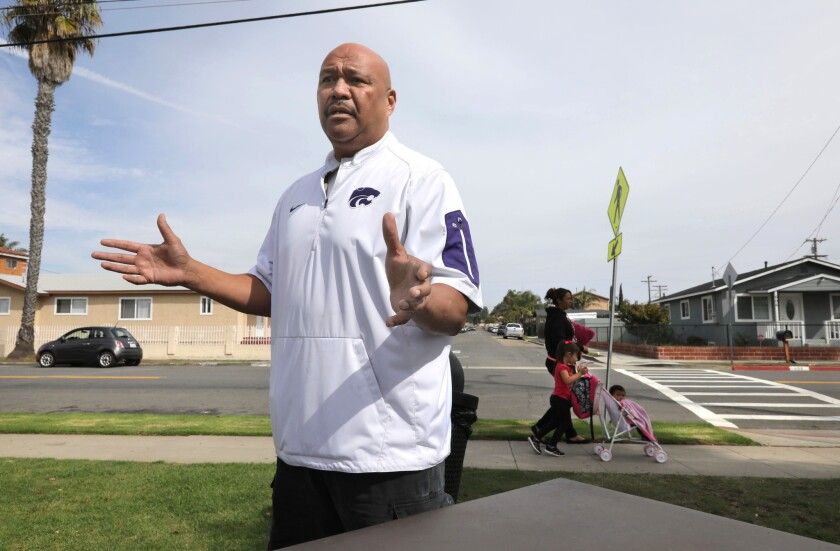 Randall Godinet, former executive director of the Oceanside Boys & Girls Club, speaks about the troubles in the city's Eastside neighborhood while standing along San Diego Street at the edge of Balderrama Park.