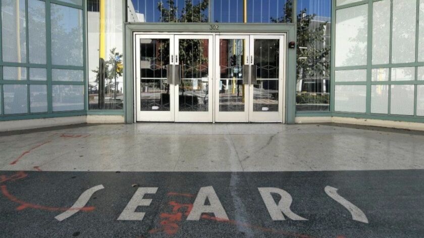 Sears Holdings Corp. is closing another 103 Kmart and Sears stores, including 11 in California. Pictured above, a Sears in Santa Monica that opened 1946 and closed last April.
