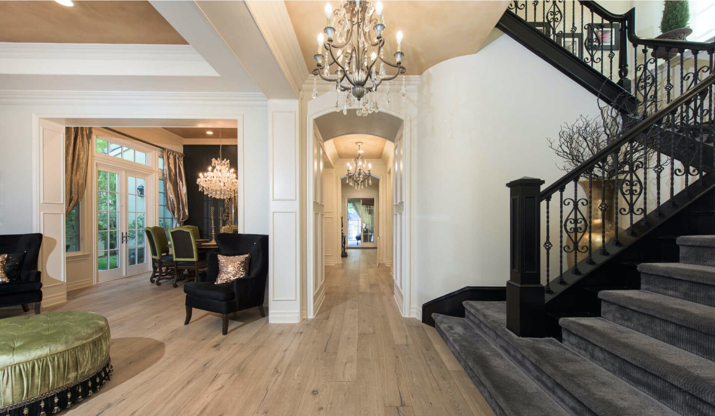 The two-story home boasts five bedrooms, six bathrooms and a handful of formal living spaces in 5,165 square feet.