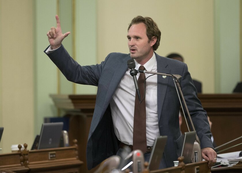 Assemblyman James Gallagher, R-Plumas Lakes, urges lawmakers to reject a measure to reduce greenhouse-gas emissions by 40 percent, Tuesday, Aug. 23, 2016, in Sacramento, Calif. The bill, SB32, by Sen. Fran Pavley, D-Agoura Hills, was approved 42-29 and sent to the Senate. (AP Photo/Rich Pedroncelli