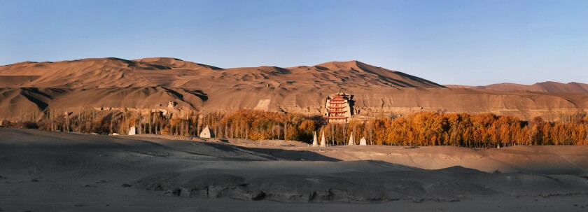 The Mogao Grottoes, carved into cliffs at the edge of the Gobi Desert.