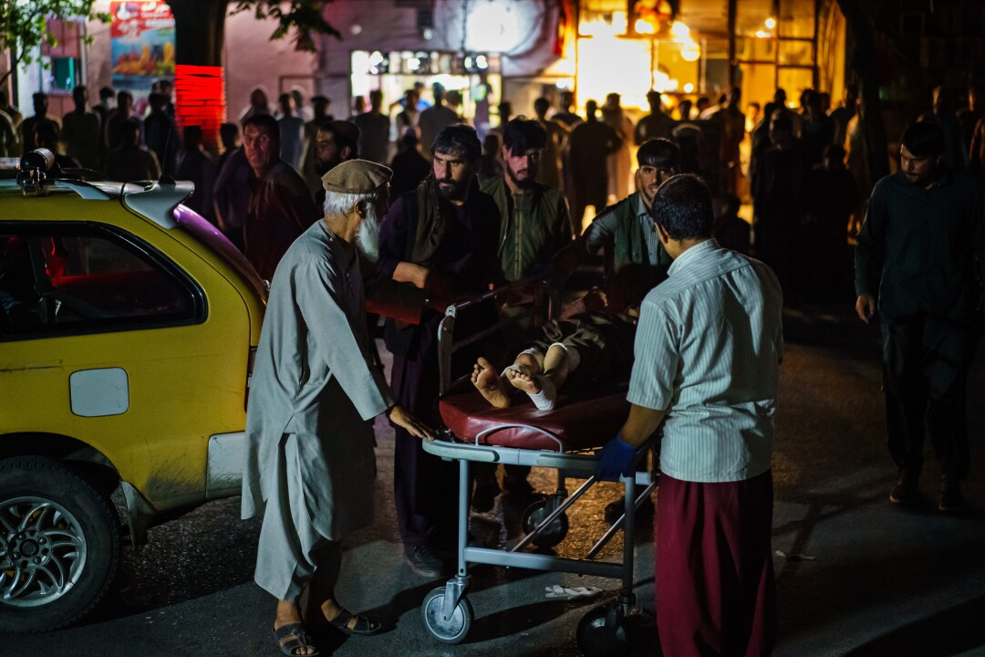 A wounded patient is brought by taxi to a hospital in Kabul, Afghanistan.