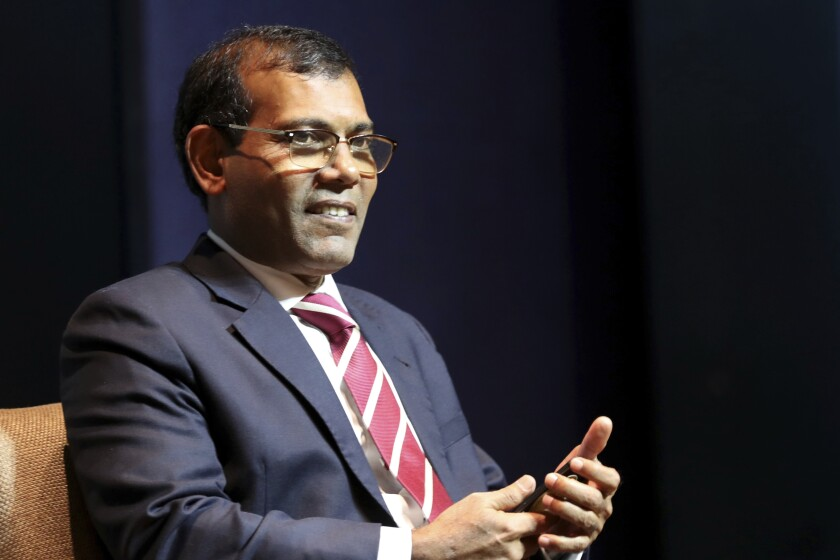 FILE - In this Feb. 14, 2019, file photo, former Maldives President Mohamed Nasheed takes a seat before delivering a lecture on climate change in New Delhi, India. A local group that sympathizes with the Islamic State group was behind the assassination attempt on former Maldives president Mohamed Nasheed last May and its leader had been arrested in 2017 for suspected bomb making and was let off without explanation, police said. (AP Photo/Manish Swarup, File)