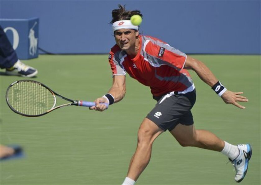 Spain's David Ferrer returns a shot to Igor Sijsling, of the Netherlands, in the third round of play at the 2012 US Open tennis tournament,  Friday, Aug. 31, 2012, in New York. (AP Photo/Henny Ray Abrams)