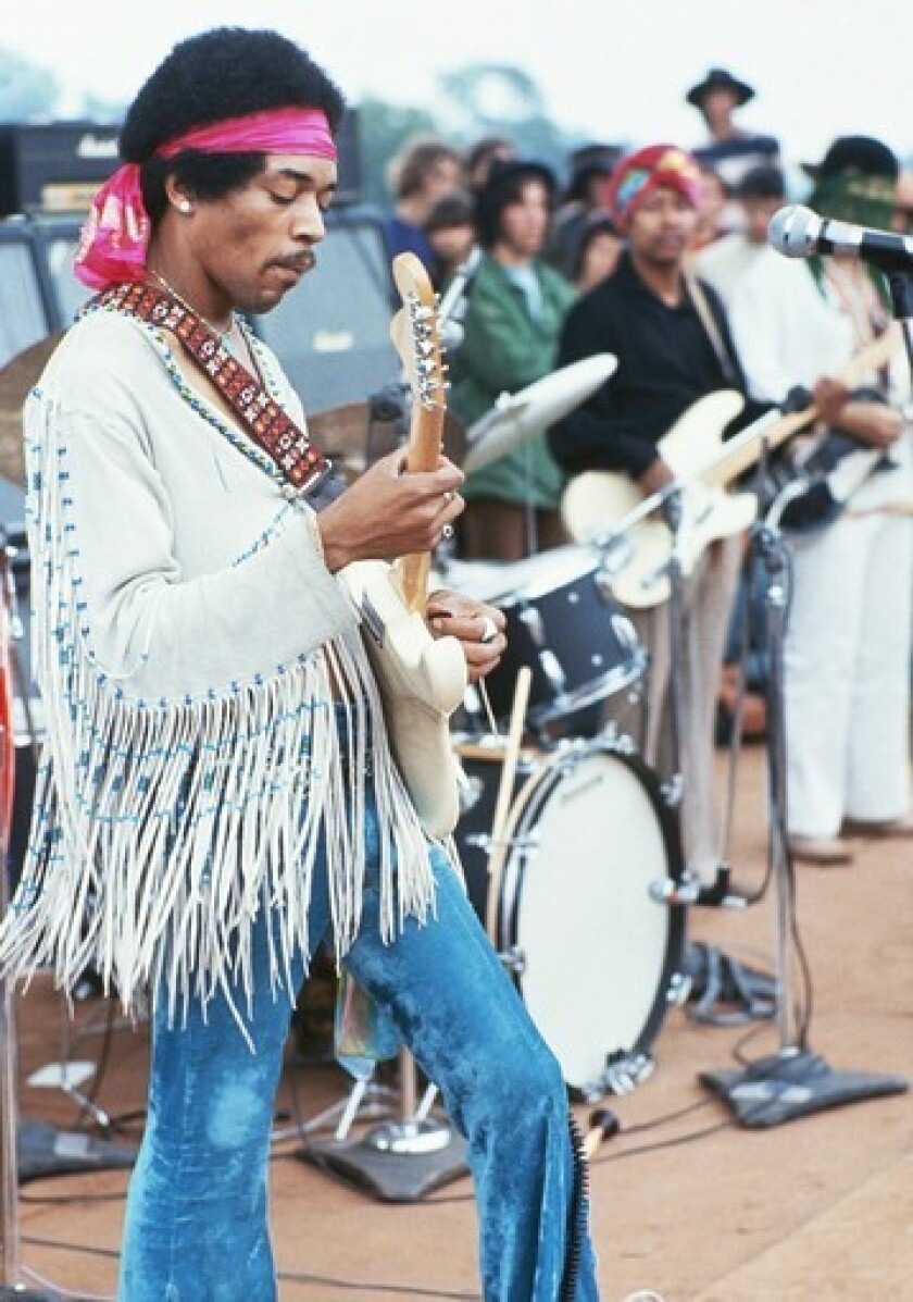 Jimi Hendrix is shown on stage at the1969 Woodstock festival. He was the final performer at the three-day festival, which ended up stretching into a fourth day after running over schedule.