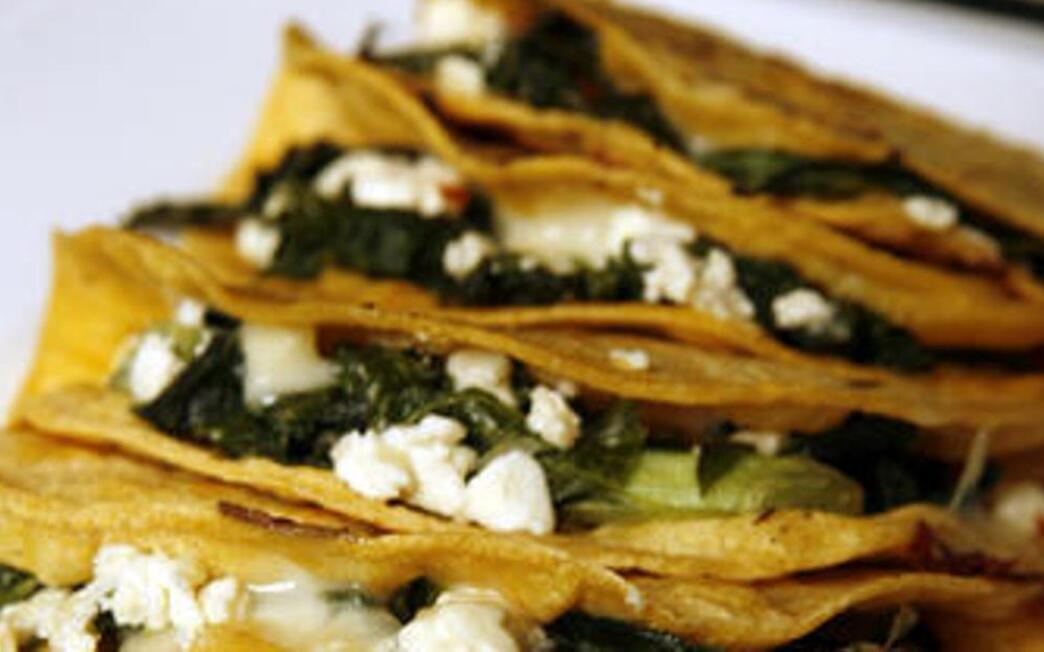 Quesadillas stuffed with greens and feta