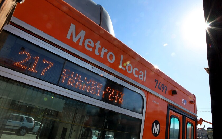 The L.A. County Metropolitan Transportation Authority says it will face a $36-million operating budget shortfall in 2016 that will grow if fares are not raised. Above, a Metro bus near Culver City in 2012.