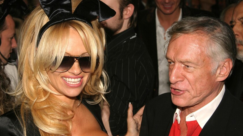 Pamela Anderson and Hugh Hefner at Playboy's 50th anniversary party