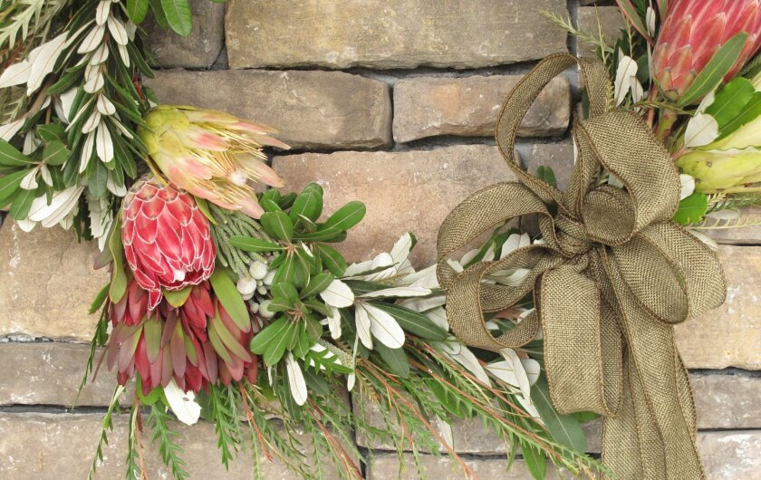 This holiday wreath was made with greenery and flowers from Fallbrook-based Resendiz Brothers Protea Growers.