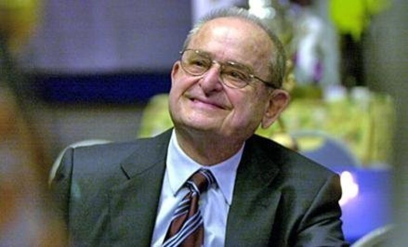 """Chargers owner Alex Spanos signs copies of his autobiography, """"Sharing the Wealth: My Story,"""" at the Hall of Champions. (2002 file photo/ U-T)"""