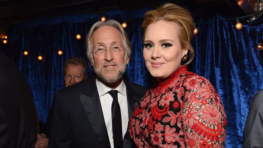 Adele (right) and Grammy Awards honcho Neil Portnow. She will perform at the 2017 Grammys and is up for five awards.