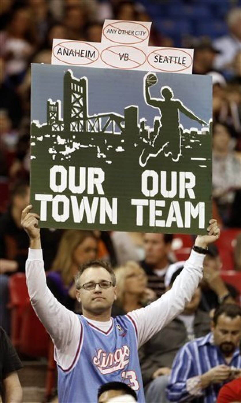 Sacramento Kings fan Paul Schiele shows his support for keeping the team in Sacramento during an NBA basketball game against the Utah Jazz, Saturday, Feb. 9, 2013,  in Sacramento, Calif.  Earlier in the week NBA Commissioner David Stern announced that the Seattle group led by investor Chris Hanson,