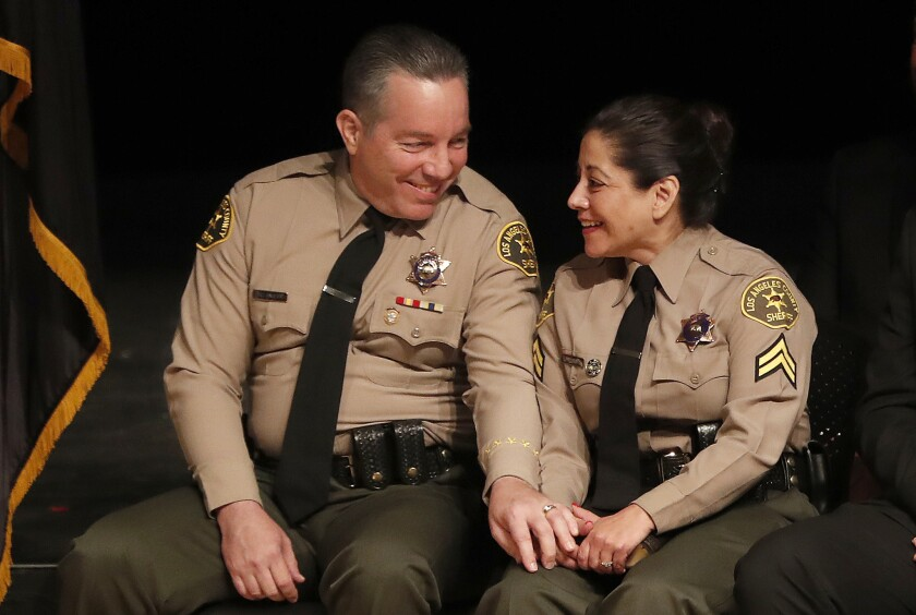 Sheriff Alex Villanueva, with his wife, Vivian, at the ceremony for his swearing in.