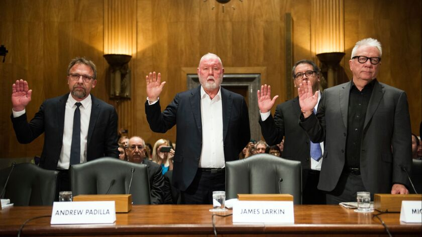 Backpage.com CEO Carl Ferrer, former owner James Larkin, COO Andrew Padilla, and former owner Michael Lacey, are sworn-in on Capitol Hill in Washington on Jan. 10, 2017.