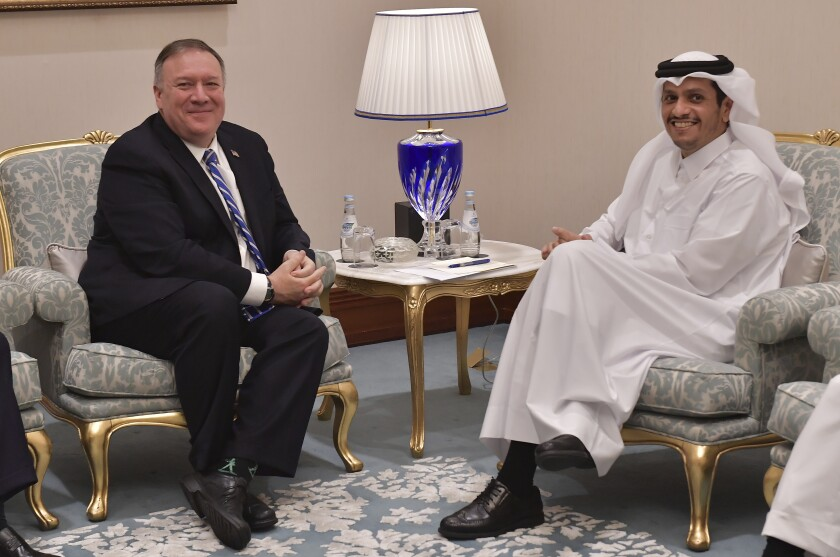 Secretary of State Michael R. Pompeo meets with Qatar's Foreign Minister Sheikh Mohammed bin Abdulrahman Al Thani before a peace signing ceremony between the U.S. and the Taliban.