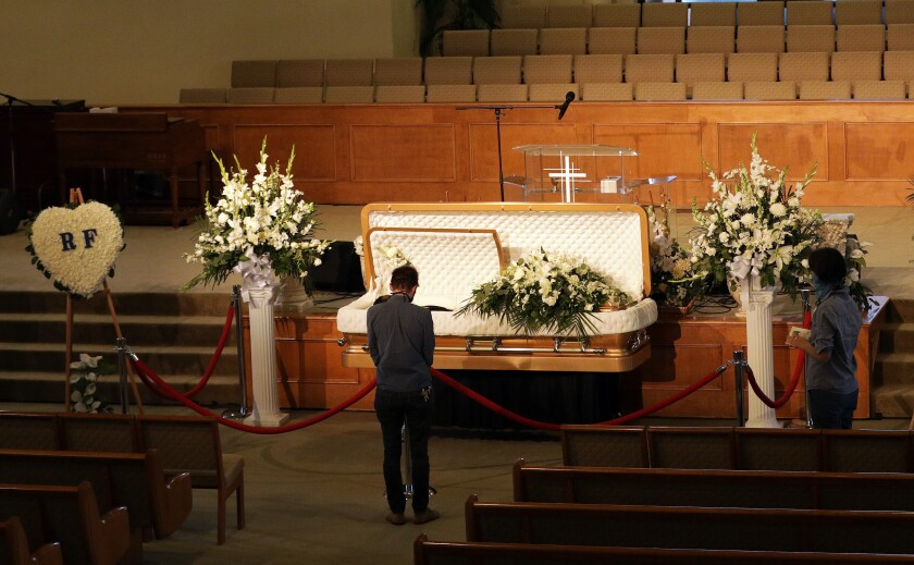 Visitors pay their respects to Robert Fuller at Living Stone Cathedral of Worship  in Littlerock, CA.