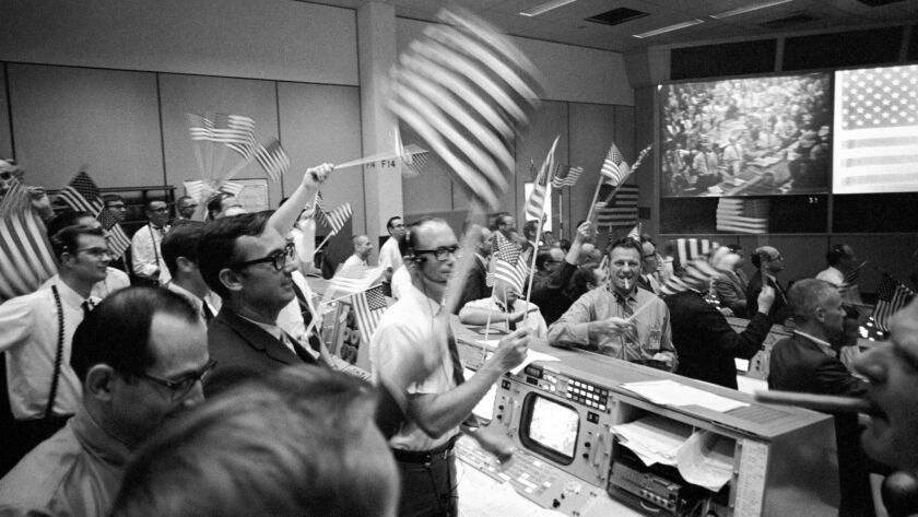 In this July 24, 1969 photo made available by NASA, flight controllers at the Mission Operations Con