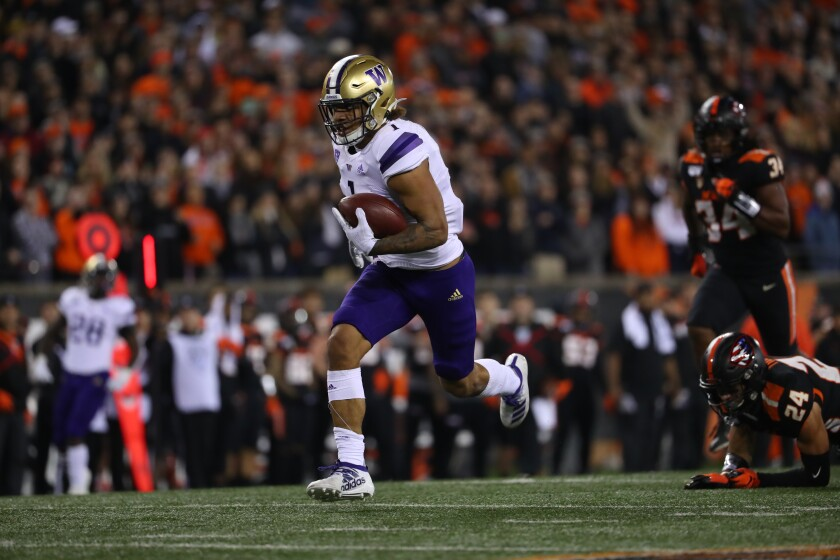Washington's Hunter Bryant runs with the ball against Oregon State in the second quarter on Friday in Corvallis, Ore.