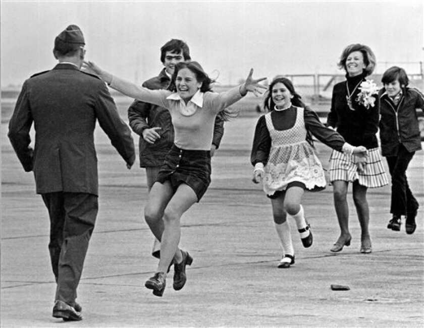 This March 17, 1973 file photo shows released prisoner of war Lt. Col. Robert L. Stirm being greeted by his family at Travis Air Force Base in Fairfield, Calif.
