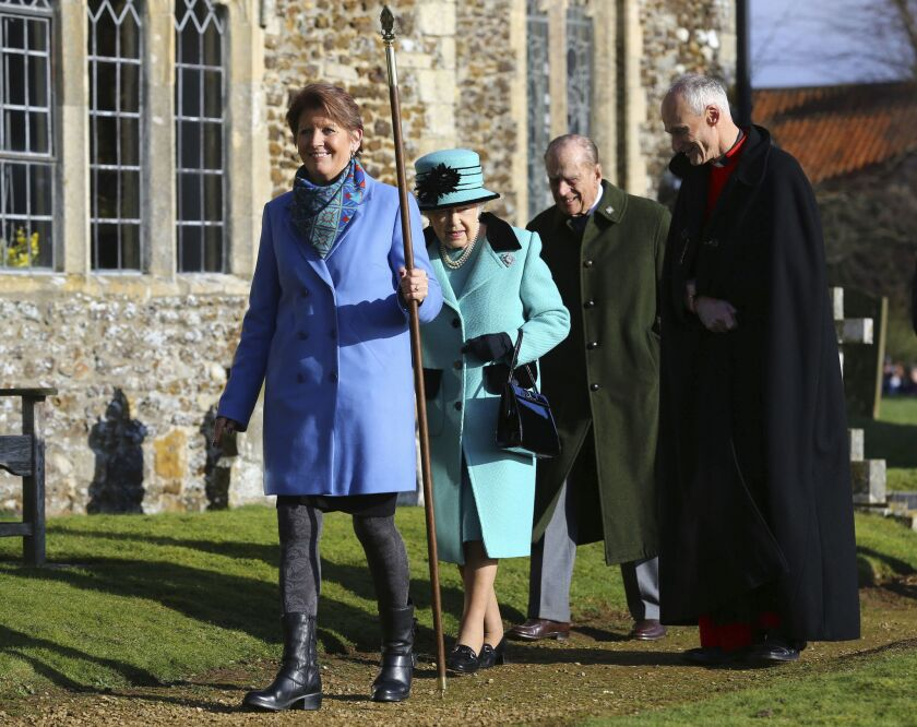 Britain's Queen Elizabeth II and her husband Duke of Edinburgh, center, arrive at St. Peter and St. Paul at West Newton, England, on Feb. 5, 2017.